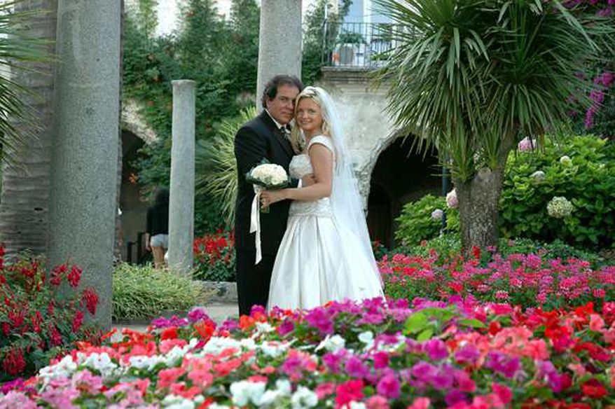 In this July 2005 photo provided by Lynn France, Lynn France, right, poses for a photo with her husband John France on their wedding day on Italy's Amalfi Coast. In January of 2009, France discovered her husband's second wedding on Facebook. (AP Photo/Courtesy of Lynn France)