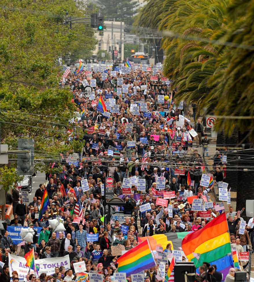 Hundreds of same-sex marriage supporters march through San Francisco celebrating a federal judge's decision overturning California's same-sex marriage ban on Wednesday, Aug. 4, 2010. Chief U.S. District Judge Vaughn Walker made his ruling in a lawsuit filed by two gay couples who claimed the voter-approved ban violated their civil rights. (AP Photo/Noah Berger)