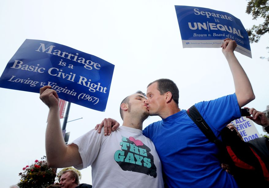David Herman, right, kisses Jeff Hannan while celebrating a federal judge's decision overturning California's same-sex marriage ban on Wednesday, Aug. 4, 2010, in San Francisco. Chief U.S. District Judge Vaughn Walker made his ruling in a lawsuit filed by two gay couples who claimed the voter-approved ban violated their civil rights. (AP Photo/Noah Berger)