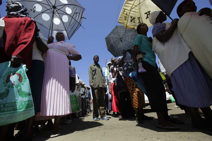 Kenyans line up at a poling station in the Rift Valley town of Nakuru, Kenya, Wednesday, Aug. 4, 2010. A vast majority of Kenyans voted yes for the new constitution. (AP Photo/Jerome Delay)
