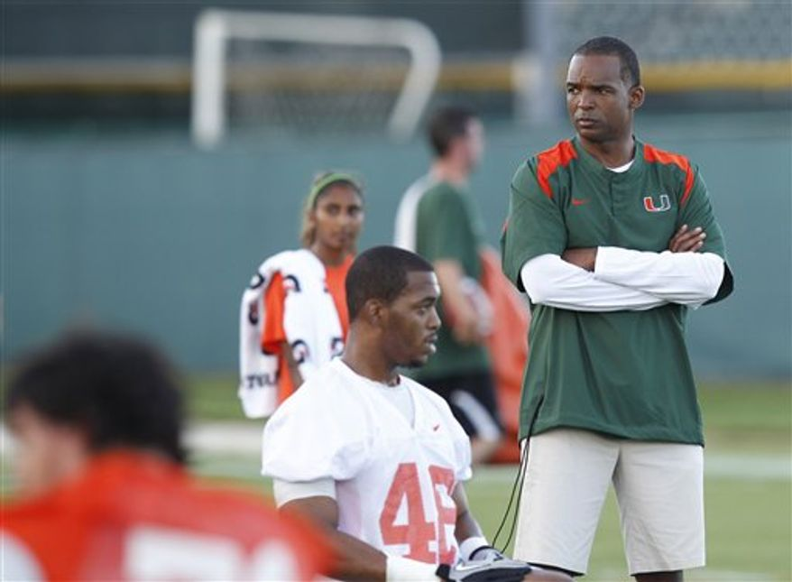 Miami quarterback Jacory Harris throws a pass as he runs through drills during the first day of training camp, Thursday, Aug. 5, 2010,  in Coral Gables, Fla. (AP Photo/Wilfredo Lee)