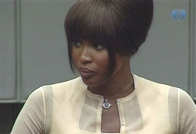 In this image made from television Naomi Campbell is seen holding the bible being sworn in at the U.N.-backed Special Court for Sierra Leone in Leidschendam, Netherlands, Thursday, Aug. 5, 2010. Naomi Campbell appeared at a Dutch courthouse to give evidence at the war crimes trial of former Liberian ruler Charles Taylor after the supermodel lost her battle to avoid testifying. Campbell will be questioned about claims made by actress Mia Farrow that Taylor gave the British model an uncut diamond after a dinner party hosted by Nelson Mandela in South Africa in 1997. Prosecutors say if that's true, it's evidence that he received diamonds from Sierra Leone rebels in exchange for weapons during that country's 1992-2002 civil war. (AP Photo/Special Court for Sierra Leone, via APTN)