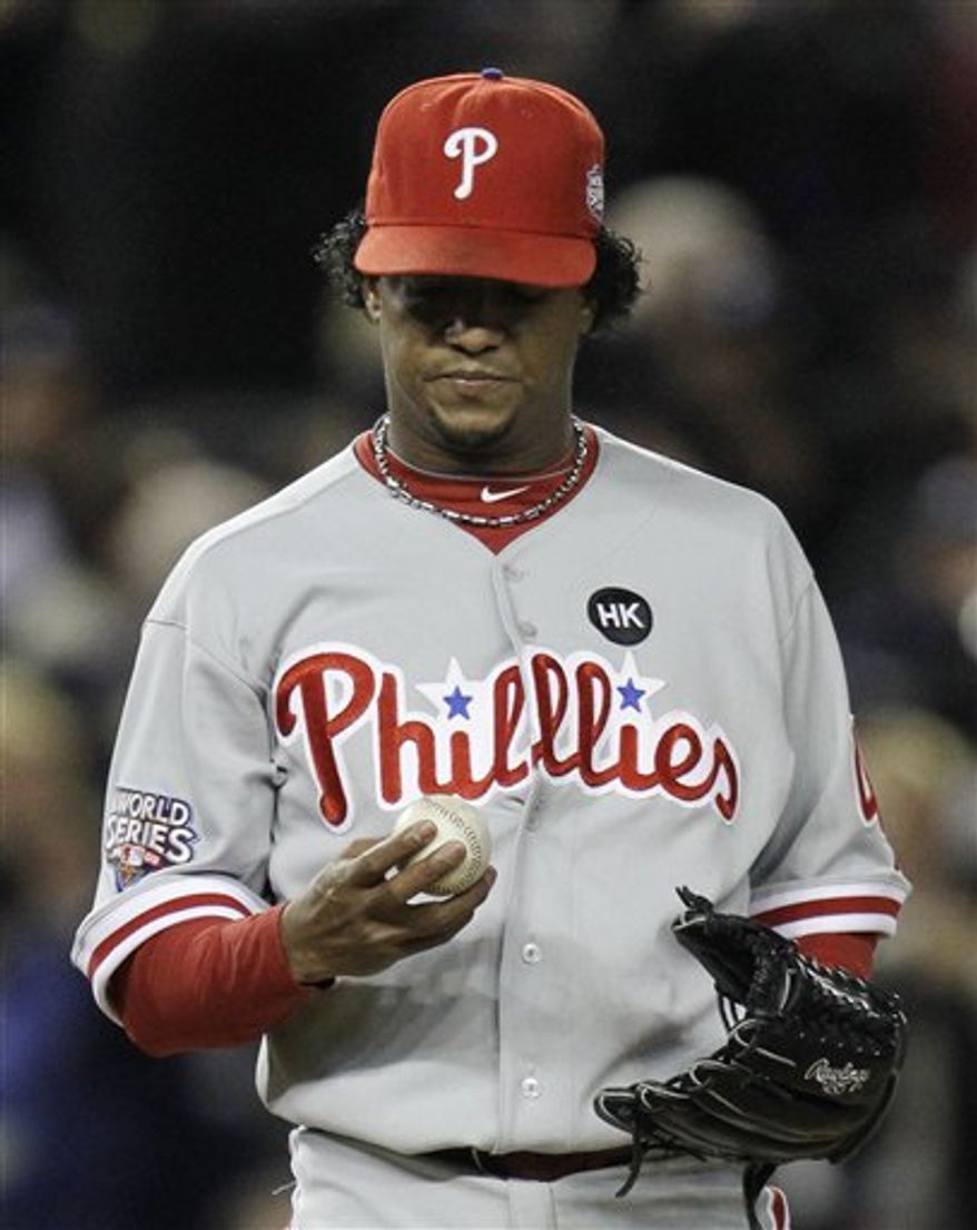 FILE - In this Nov. 4, 2009, file photo, Philadelphia Phillies' Pedro Martinez looks at his ball after giving up a two-run home run to New York Yankees' Hideki Matsui during the second inning of Game 6 of the Major League Baseball World Series in New York. Martinez said Thursday, Aug. 5, 2010, he plans to stay retired despite offers the past two weeks from several teams. The three-time Cy Young Award winner says he turned them down but was flattered by the invitations. (AP Photo/David J. Phillip, File)
