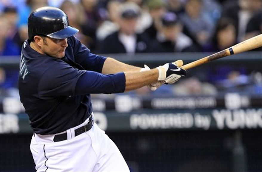 FILE - In this May 31, 2010, file photo, Seattle Mariners' Mike Sweeney bats against the Minnesota Twins during a baseball game in Seattle. The Seattle Mariners traded five-time All-Star hitter Mike Sweeney to the Philadelphia Phillies on Wednesday, Aug. 4, 2010, for a player to be named later or cash considerations. (AP Photo/Elaine Thompson)