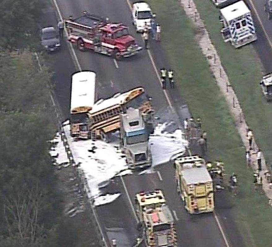 This image made from video provided by KTVI shows responders at the scene of an accident involving two school buses, a pickup truck and a tractor-trailer rig on Thursday, Aug. 5, 2010, on eastbound Interstate 44 near Gray Summit, Mo. A girl on one of the buses and the driver of the pickup were killed. (AP Photo/KTVI)