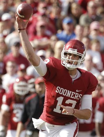 FILE - Inthis Nov. 28, 2009, file photo, Oklahoma quarterback Landry Jones passes against Oklahoma State in the first quarter of an NCAA college football game in Norman, Okla. Jones actually played most of last season because starting quarterback Sam Bradford was hurt. His experience, plus the combo of running back DeMarco Murray and receiver Ryan Broyles and a stout defense, are among the reasons the Sooners are favored to regain their status atop the South. (AP Photo/Sue Ogrocki, File)