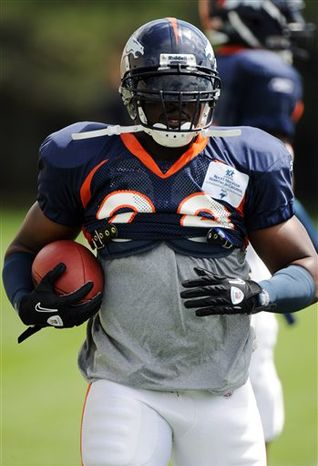 Denver Broncos linebacker Elvis Dumervil runs a drill during NFL football training camp at Broncos headquarters in Englewood, Colo., Monday, Aug. 2, 2010. (AP Photo/Jack Dempsey)