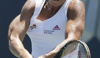 Agnieszka Radwanska, of Poland, flips her racket after missing a shot against Daniela Hantuchova, Slovakia, during the Mercury Insurance Open tennis tournament in Carlsbad, Calif., Saturday, Aug. 7, 2010. (AP Photo/Chris Carlson)