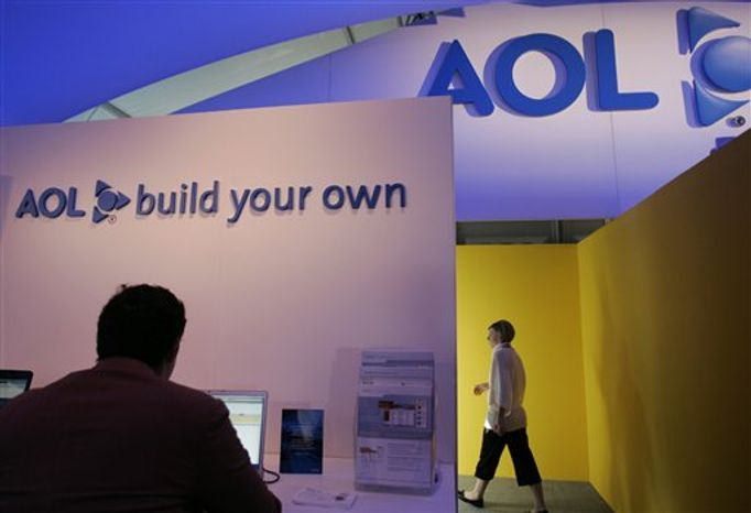 FILE - In this May 7, 2008 file photo, a show attendee leaves the AOL booth at the Consumer Electronics Show (CES) in Las Vegas. Internet company AOL said Wednesday, Aug. 4, 2010, a $1.4 billion accounting charge pushed the company to a $1 billion-plus net loss in the second quarter. (AP Photo/Paul Sakuma)