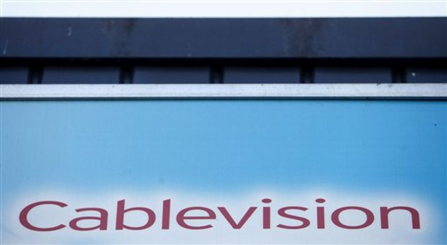 FILE - This file photo made March 7, 2010, shows a Cablevision sign in New York. Cablevision Systems Corp. said Thursday, Aug. 5, 2010, said its second-quarter profit fell sharply as a hefty loss related to paying down debt helped offset revenue gains as more people signed up for its video, Internet and phone services. (AP Photo/Seth Wenig, File)