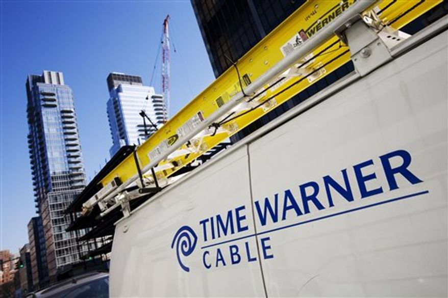 FILE - In this Feb. 2, 2009 file photo, a Time Warner Cable truck is parked in New York. Time Warner Cable Inc., the country's second-largest cable company said Thursday, Nov. 4, 2010, it lost more video subscribers in the latest quarter than it ever has before,  (AP Photo/Mark Lennihan, file)