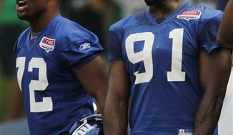 New York Giants offensive linemen Chris Snee (76), Rich Seubert (69), David Diehl (66) and Will Beatty (65) break huddle during NFL football training camp in Albany, N.Y., on Monday, Aug. 2, 2010. (AP Photo/Mike Groll)