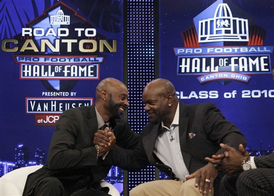 FILE - This Feb. 6, 2010, file photo shows Jerry Rice, left, and Emmitt Smith sharing a moment after they were elected to the Pro Football Hall of Fame, in Fort Lauderdale, Fla.  On Saturday night, Aug. 7, they will be inducted together in Canton, Ohio. (AP Photo/Wilfredo Lee, FileFeb. 6, 2010)