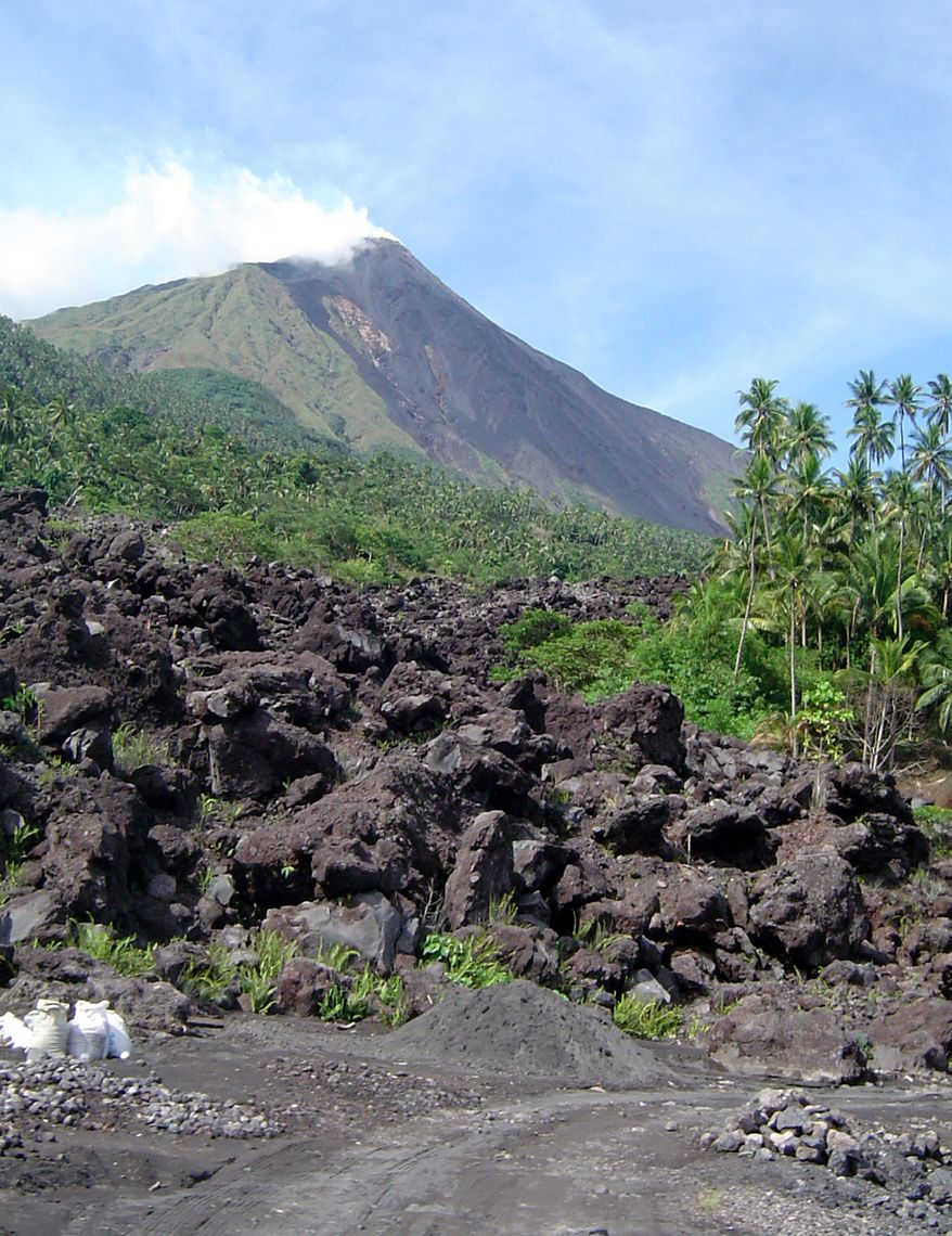 Debris from the Mount Karangetang volcano lies on the shoulder of the mountain in Siau, part of Indonesia's Sulawesi island chain , in this July 27, 2006, file photo. A disaster official said Mount Karangetang spewed lava and hot ash hundreds of yards into the air on Friday Aug. 6, 2010. Mount Karangetang is located on Siau, part of the Sulawesi island chain. (AP Photo/Arter, File)
