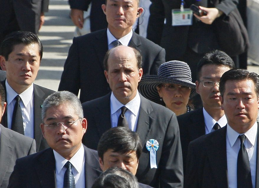 U.S. Ambassador to Japan John Roos, center, leaves the Hiroshima Peace Memorial Park after the 65th anniversary of the world's first atomic bombing in Hiroshima, western Japan, Friday, Aug. 6, 2010. The United States sent its first ever delegation to the ceremony marking the anniversary of the attacks. (AP Photo/Shuji Kajiyama)