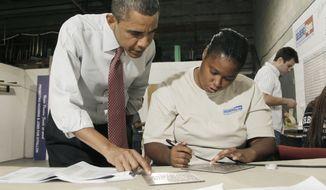 President Obama talks with Gelberg Signs employee Elaine Hart during his tour of the facility, Friday, Aug. 6, 2010, in Washington. (AP Photo/Pablo Martinez Monsivais)
