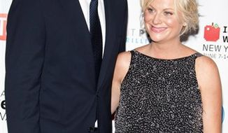 In this June 14, 2010 photo, Will Arnett and Amy Poehler arrive to the 14th Annual Webby Awards in New York. (AP Photo/Charles Sykes)