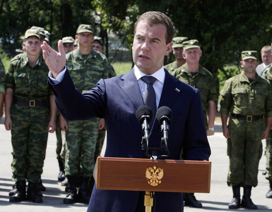 Russian President Dmitry Medvedev speaks to Russian troops stationed at the key Black Sea port of Gudauta in Abkhazia. Mr. Medvedev pledged Sunday to provide further support to breakaway Georgian regions on the anniversary of the Russian-Georgian war. He arrived in Abkhazia to hold talks with the Kremlin-friendly separatist government. (Associated Press)