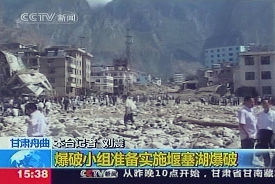 In this image made from TV footage, rocks and mud are left by landslides in Zhouqu, in China's Gansu province, on Sunday, Aug. 8, 2010. Rubble-strewn floodwaters tore through a remote corner of northwestern China on Sunday, smashing buildings, overturning cars and killing at least 127 people. (AP Photo/CCTV via APTN)
