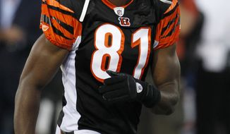 ASSOCIATED PRESS Cincinnati Bengals  wide receiver Terrell Owens runs back to the line of scrimmage in the first quarter of the Hall of Fame NFL football game against the Dallas Cowboys Sunday, Aug. 8, 2010, in Canton, Ohio.
