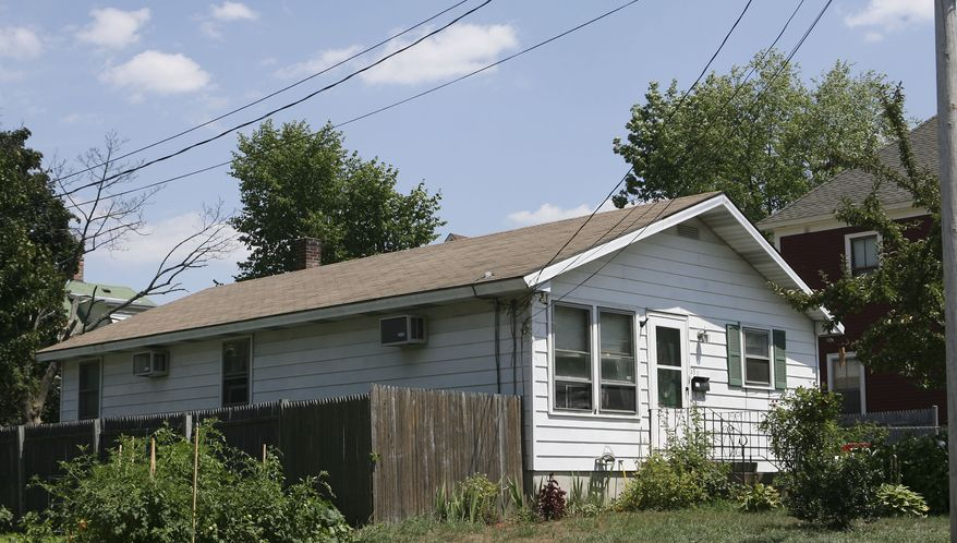 Beatrice Munyenyezi, 40, bought this three-bedroom house on Howe Street in Manchester, N.H., in 2003 for $190,000. Federal prosecutors say Mrs. Munyenyezi directed kidnapping, rape and murder during the genocide in Rwanda in 1998. (AP Photo/Jim Cole)