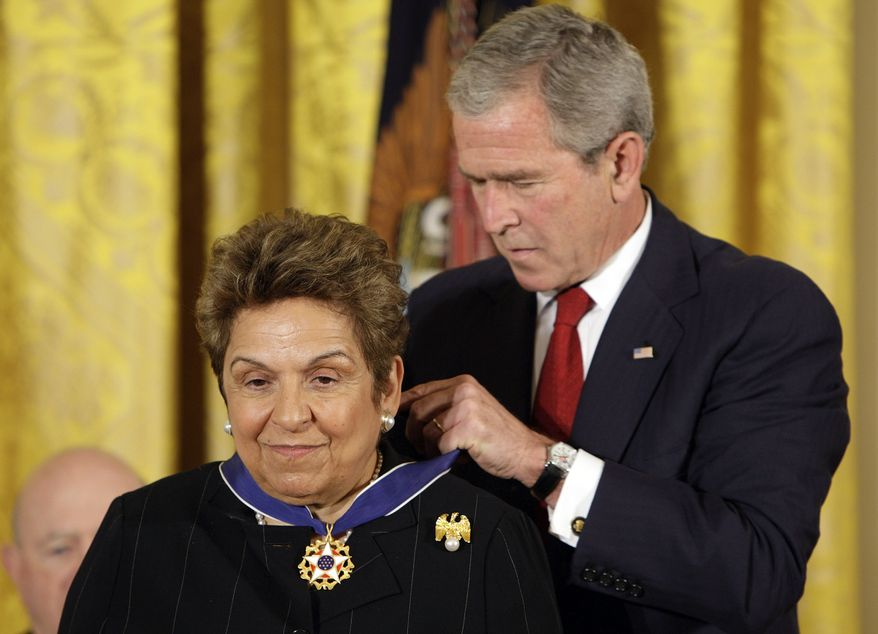 ** FILE ** President George W. Bush awards the Presidential Medal of Freedom to Donna Shalala, president of the University of Miami and former secretary of health and human services, in the East Room of the White House in Washington in June 2008. (AP Photo/Ron Edmonds, File)