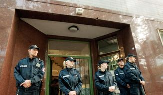 Police guard the entrance to the Taiba mosque in Hamburg, Germany, after it ws closed Monday. Once a meeting place for Sept. 11 plotters, it appeared to have become a jihad center again. (Associated Press)
