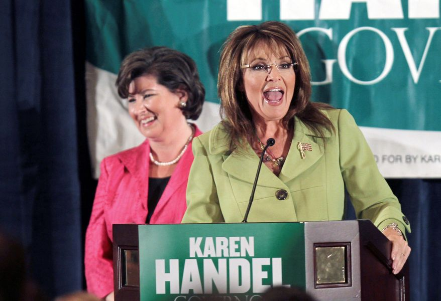 Former Alaska Gov. Sarah Palin (right) goes to bat for Georgia gubernatorial candidate Karen Handel at a rally for Mrs. Handel on Monday in Atlanta. Mrs. Handel faces former Rep. Nathan Deal in a runoff Tuesday for the Republican nomination. (Associated Press)