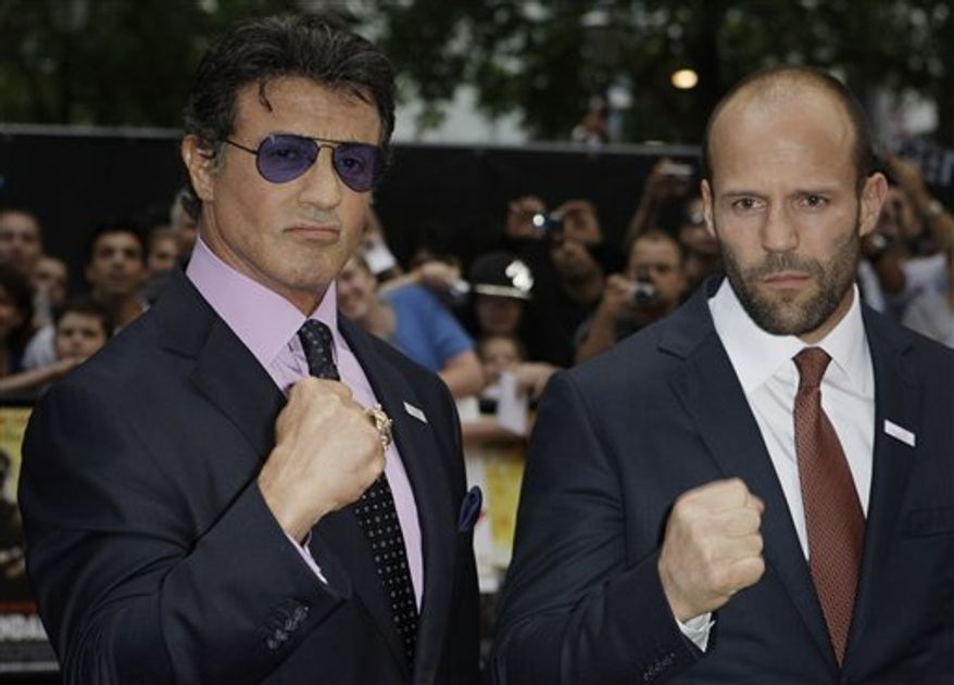 U.S. actor Sylvester Stallone, right, is mobbed by fans as he arrives for the UK premiere for the film The Expendables, at a central London cinema, Monday, Aug. 9, 2010. (AP Photo/Joel Ryan)
