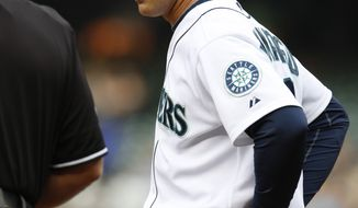 ASSOCIATED PRESS Seattle Mariners' manager Don Wakamatsu argues a call with the home plate umpire in the first inning against the Texas Rangers during a baseball game in Seattle, on Thursday, Aug. 5, 2010.