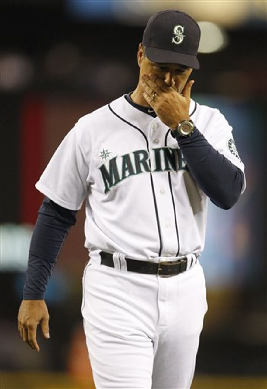 Seattle Mariners' manager Don Wakamatsu walks back to the dug out after pulling a pitcher in the sixth inning against the Kansas City Royals during a baseball game in Seattle, on Saturday, Aug. 7, 2010. (AP Photo/Kevin P. Casey)