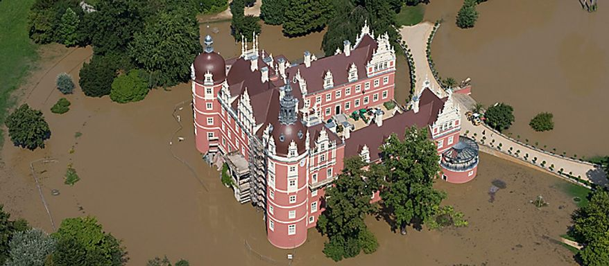 Aerial view shows the castle in Bad Muskau, Germany, partly flooded by the Neisse river on  Monday Aug. 9, 2010. The park of the castle is a UNESCO  World Heritage Site. Poles, Czechs and Germans struggled Monday to clean up homes and towns badly damaged as the waters of deadly weekend flooding began to recede. But the swollen rivers pushed northward, and other towns and villages braced for possible high waters.  The floods have killed more than 10 people.  (AP Photo/ddp/ Klaus-Dietmar Gabbert)