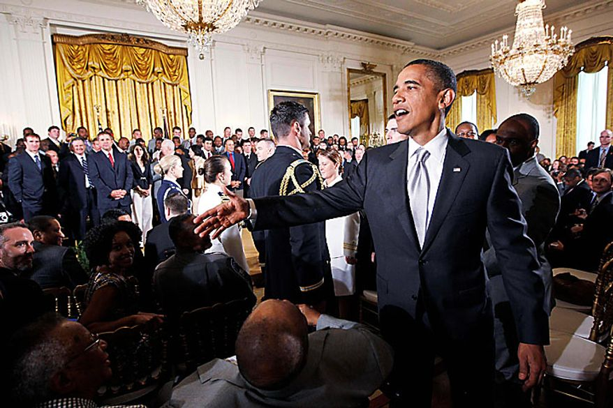President Obama greets guests in the East Room of the White House in Washington, Monday, Aug. 9, 2010, after a ceremony in which he honored the 2009 NFL Super Bowl-winning New Orleans Saints. (AP Photo/Charles Dharapak)