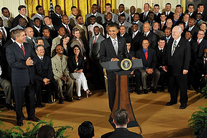 President Obama (center) welcomes the Super Bowl-winning New Orleans Saints to the White House in Washington on Monday, August 9, 2010. Mr. Obama was joined by head coach Sean Payton (left) and team owner Tom Benson. (UPI/Kevin Dietsch)