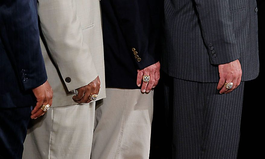 Members of the New Orleans Saints football team sport their Super Bowl rings during a ceremony in the East Room of the White House in Washington on Monday, Aug., 9, 2010. (AP Photo/Pablo Martinez Monsivais)