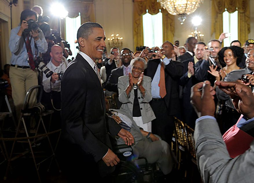 President Obama arrives in the East Room of the White House in Washington on Monday, Aug. 9, 2010, for a ceremony honoring the Super Bowl-winning New Orleans Saints. (AP Photo/Susan Walsh)