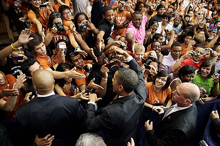 President Barack Obama greets the crowd after he speaks at the University of Texas in Austin, Texas, Monday, Aug. 9, 2010. (AP Photo/Carolyn Kaster)