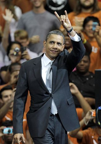 "President Barack Obama gives a ""hook 'em horns"" sign before a speech at Gregory Gym at the University of Texas in Austin, Texas, Monday, Aug. 9, 2010.  (AP Photo/LM Otero)"