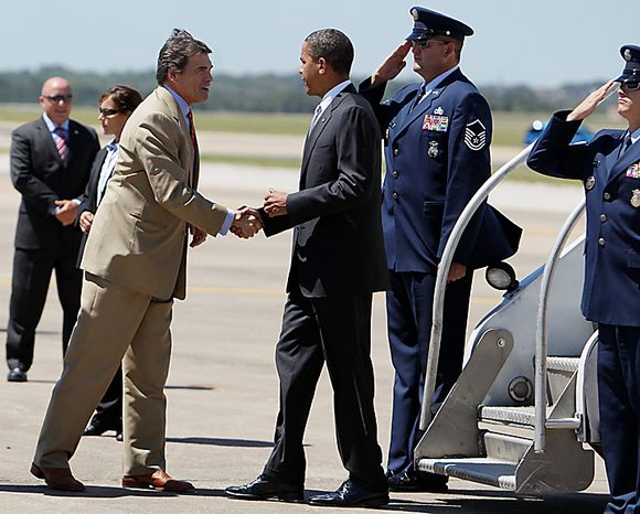 President Barack Obama is greeted by Texas Gov. Rick Perry upon his arrival at Austin Bergstrom International Airport in Austin, Texas, Monday, Aug. 9, 2010. (AP Photo/Carolyn Kaster)