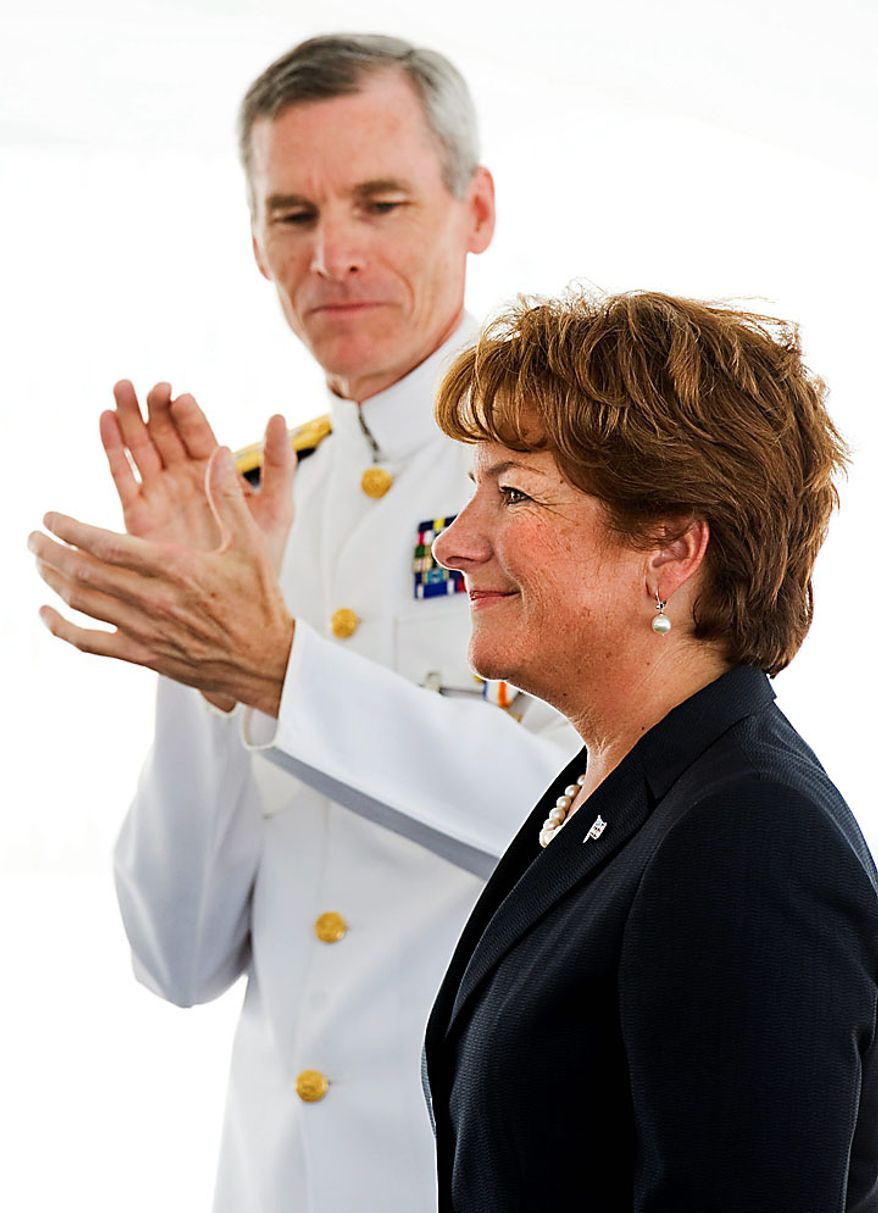 Letitia A. Long (right) is applauded by Vice Adm. Robert Murrett as she takes over as director of the National Geospatial-Inteligence Agency from Adm. Murrett on Monday, Aug. 9, 2010, during a change-of-director ceremony at the agency in Springfield, Va. (AP Photo/Cliff Owen)