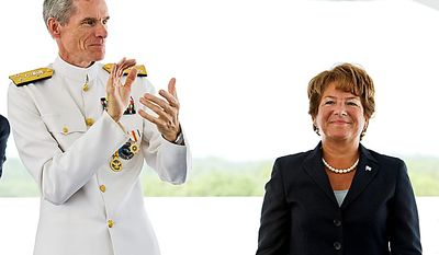 Letitia A. Long (right) is applauded by Vice Adm. Robert Murrett as she takes over as director of the National Geospatial-Inteligence Agency from him on Monday, Aug, 9, 2010, during a change-of-director ceremony in Springfield, Va., on Monday, Aug. 9, 2010. (AP Photo/Cliff Owen)