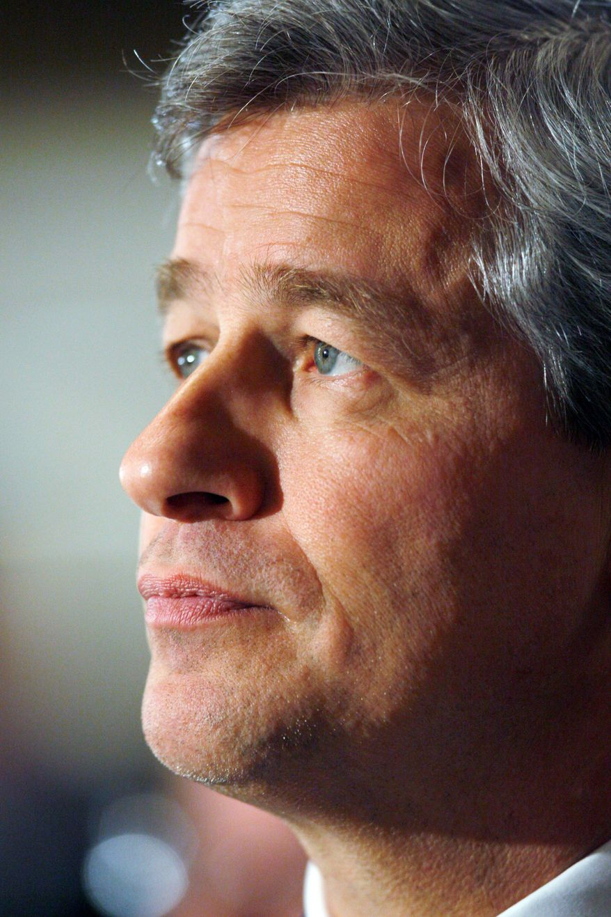 ASSOCIATED PRESS JPMorgan Chase CEO Jamie Dimon listens to an address by President Obama in Washington in March.