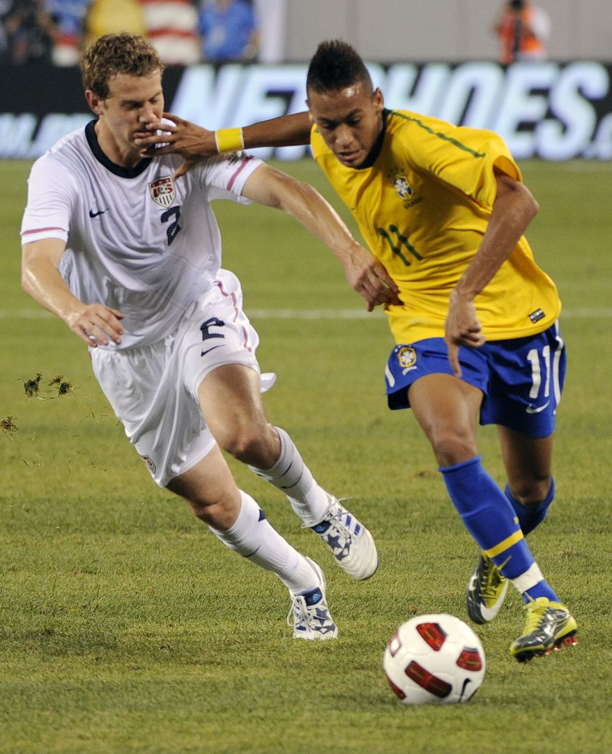 ** FILE ** Brazil midfielder Neymar (right) holds off U.S. defender Jonathan Spector as he dribbles the ball during the first half of an international soccer match Tuesday, Aug. 10, 2010, at New Meadowlands Stadium in East Rutherford, N.J. (AP Photo/Bill Kostroun, File)