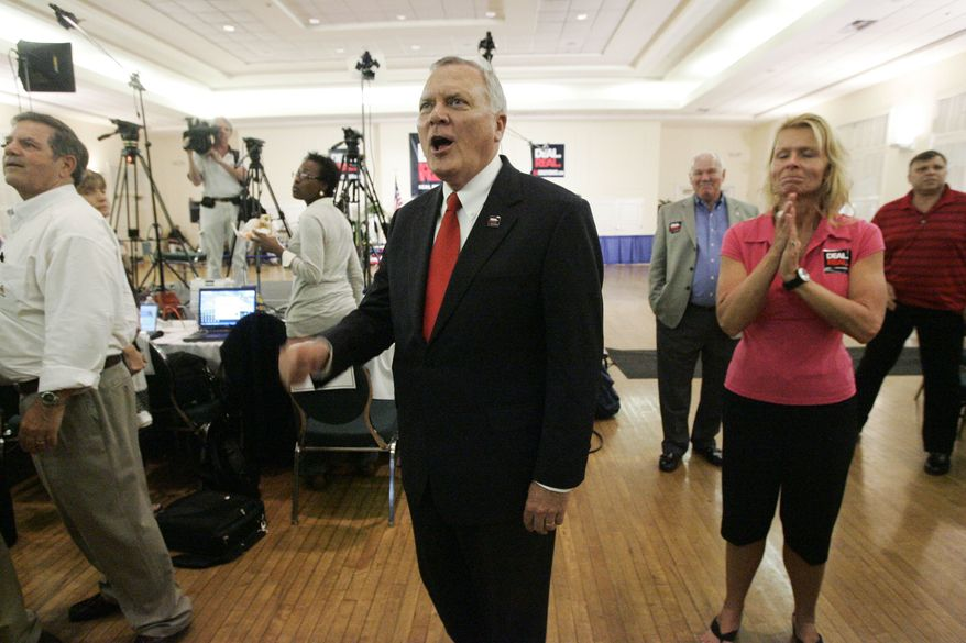 ASSOCIATED PRESS Georgia gubernatorial candidate Nathan Deal  reacts while watching polling results as they are broadcast during a republican primary runoff election gathering Tuesday, August, 10, 2010, in Gainesville, Ga.