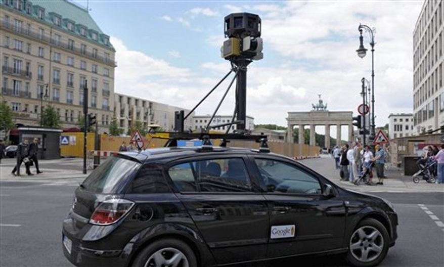 "FILE - In this July 9, 2008 file photo a Google street mapping car drives in Berlin , Germany near Brandenburg gate. Google Inc. will introduce its ""Street View"" mapping feature in Germany before the end of the year, the company said on Tuesday, Aug. 10, 2010. The feature will be available for the country's 20 biggest cities and people can ask to have the photo of their house removed from the database starting next week _ a move aimed at dispelling privacy fears. (AP Photo/ddp, Michael Kappeler, File)"