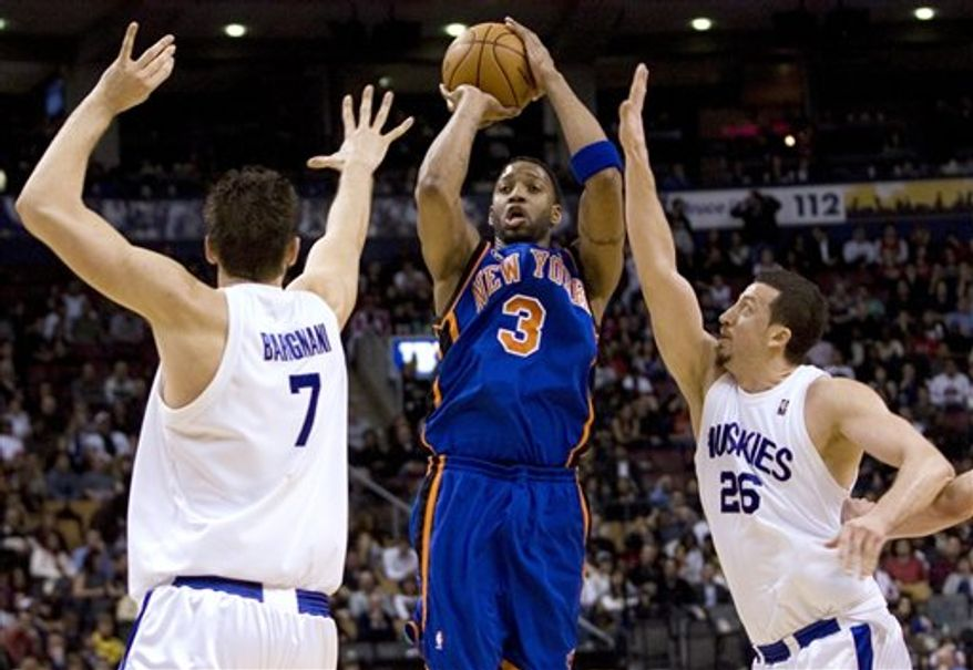 FILE - This March 5, 2010, file photo shows New York Knicks' Tracy McGrady (3) shooting despite pressure from Toronto Raptors' Andrea Bargnani, left, and Hedo Turkoglu, right, during the first half of an NBA basketball game in Toronto. A person familiar with the negotiations tells The Associated Press that Tracy McGrady has agreed to terms of a one-year contract with the Detroit Pistons. The person, who spoke Tuesday, Aug. 10, 2010,  on the condition of anonymity because the deal hasn't been announced, says McGrady will play for $1.3 million this season. (AP Photo/The Canadian Press, Chris Young, File)