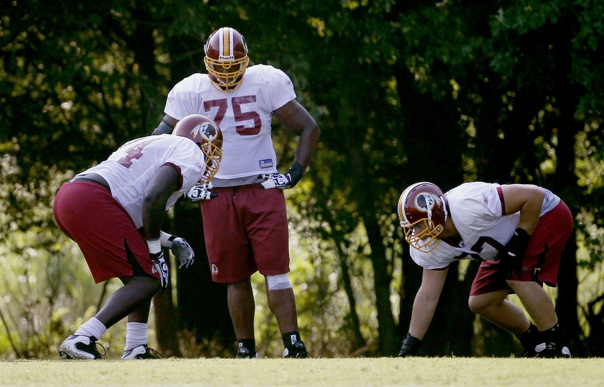 ASSOCIATED PRESS Washington Redskins guard Artis Hick (75), center, tackle Stephon Heyer (74) and guard Chad Rinehart (77) drill at the NFL football team's training camp at Redskins Park in Ashburn, Va., Tuesday, Aug., 10, 2010.