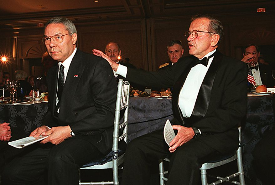 Alaska Senator Ted Stevens (right), one of this year's USO honorees, gives a pat on the back to his good friend, former chairman of the Joint Chiefs of Staff Gen. (ret.) Colin Powell (left), March 29, 2000. Behind them can be seen actor Gerals McRaney and the current chairman of the Joint Chiefs, Gen. Richard Shelton.  ( James R. Brantley / The Washington Times )
