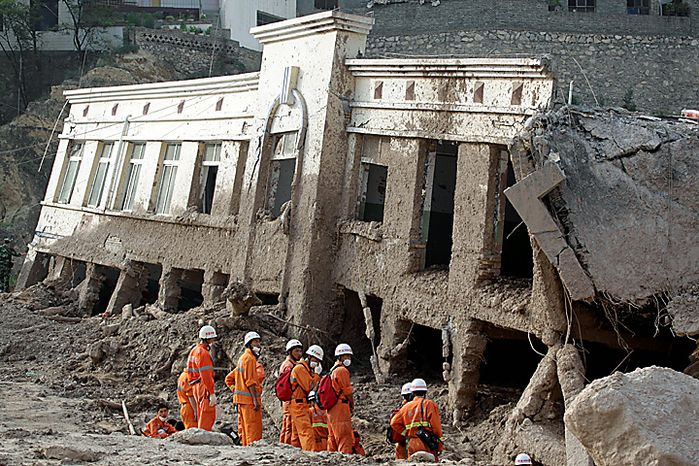 Chinese rescue workers prepare to search for survivors after a mudslide swept through the town of Zhouqu in Gannan prefecture of northwestern China's Gansu province, Tuesday, Aug. 10, 2010. Rescuers in three countries across Asia struggled Tuesday to reach survivors from massive flooding that has afflicted millions of people, as the death toll climbed in the remote Chinese town where hundreds died and more than 1,100 were missing from landslides.  (AP Photo/Ng Han Guan)