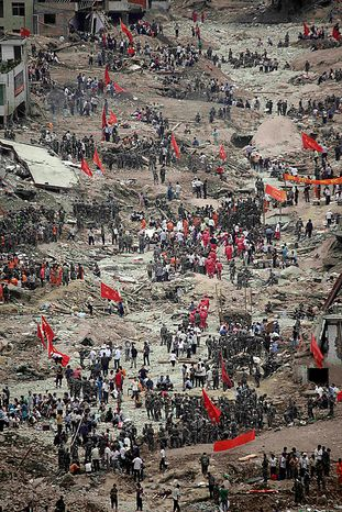 Rescue workers and residents search for victims after a mud slide swept into the town of Zhouqu in Gannan prefecture of northwestern China's Gansu province, Tuesday, Aug. 10, 2010. (AP Photo/Ng Han Guan)